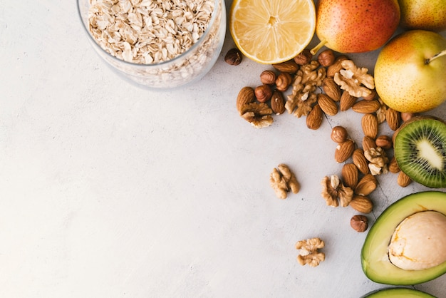 Top view fruit and nuts breakfast with copy space Premium Photo