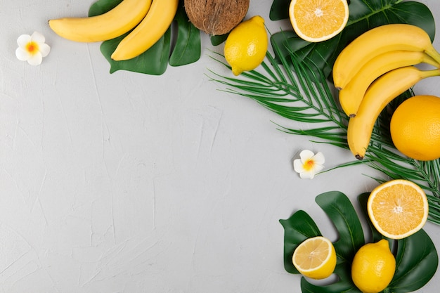 Top view of fruits on plain background with copy space Free Photo