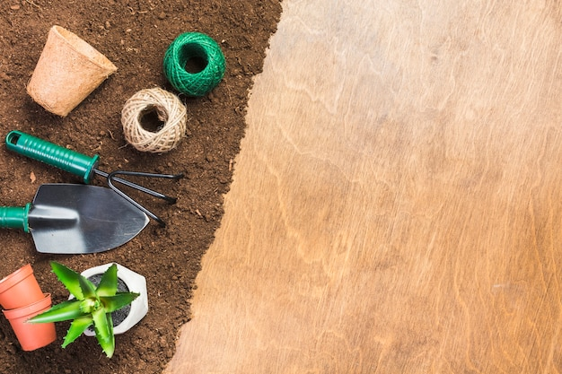Top view of gardening tools on the ground Premium Photo