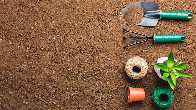 Top View Of Gardening Tools On The Ground Free Photo