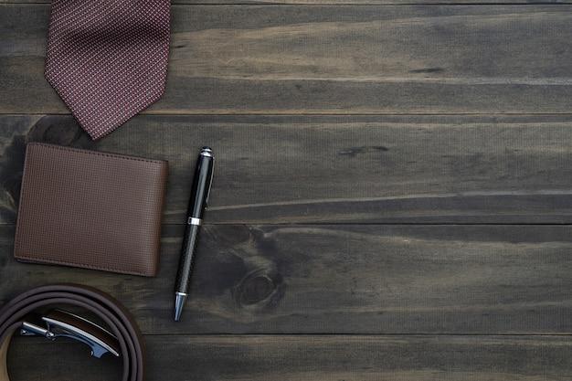 Top view of gentlemen accessories on wood background. Premium Photo