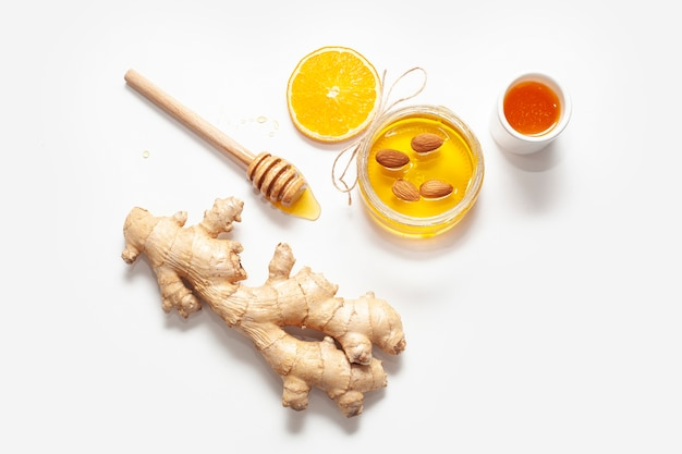 Top view ginger with honey stick Free Photo