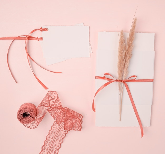 Top view girly arrangement for wedding invitations on pink background Free Photo