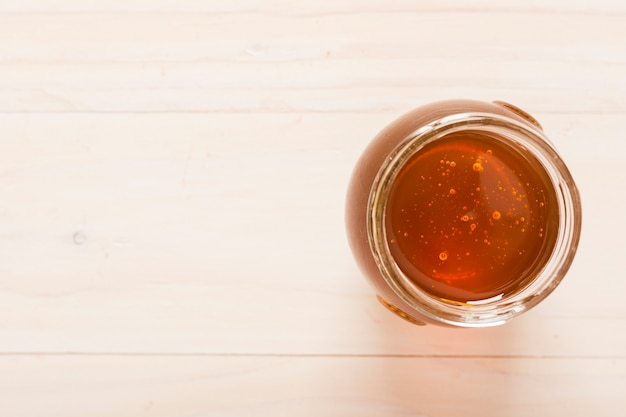 Top view glass jar full of honey Free Photo