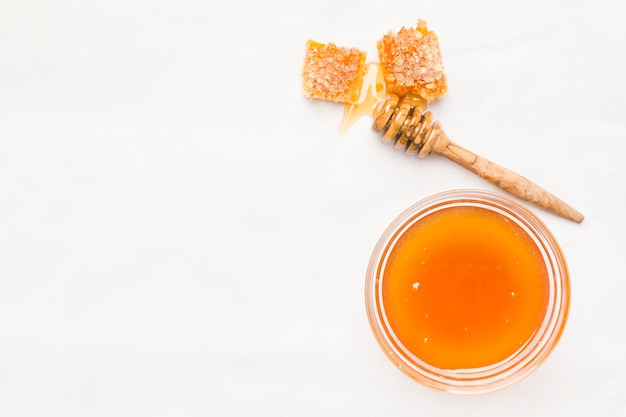 Top view glass jar full of honey Free Photo