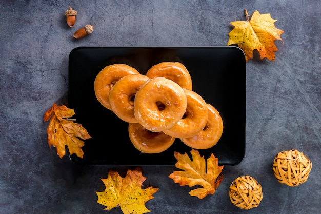 Top view glazed donuts on plate Free Photo