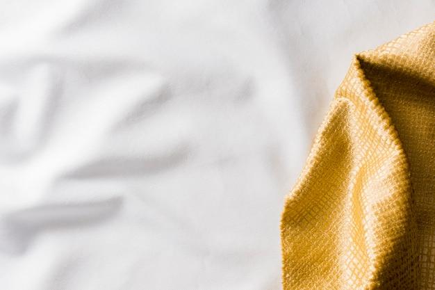 Вид сверху золотая текстура ткани Бесплатные Фотографии