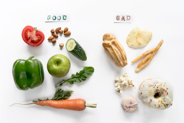 Top view of good and bad food over isolated on white background Free Photo