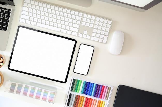 Top view graphic designer workspace with creative supplies Premium Photo