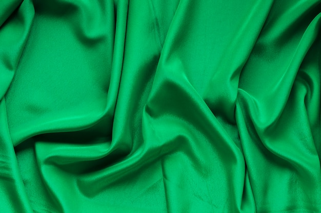 Top view of green fabric for carnival Free Photo
