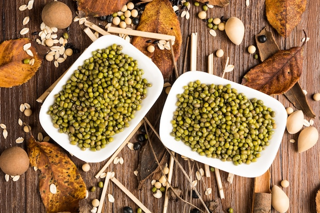 Top view of green lentils on a plank Free Photo