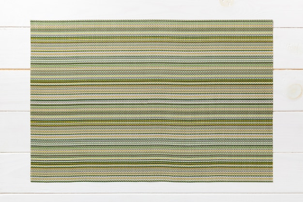 Top view of green table napkin on wooden table. place mat Premium Photo
