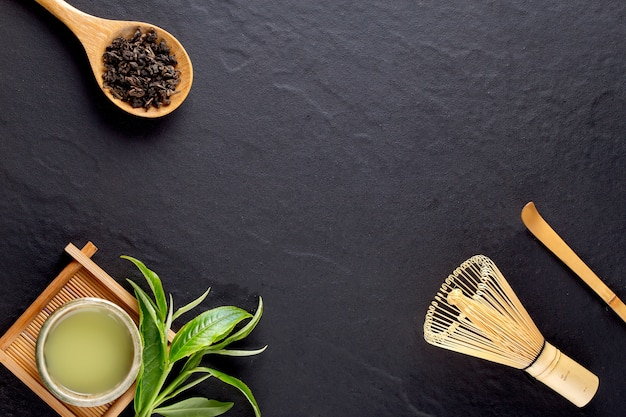 Top view of green tea matcha in a bowl on wooden surface Premium Photo