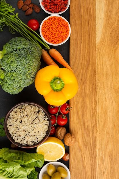 Top view of groceries with cutboard Free Photo