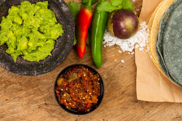 Top view guacamole and salsa for tortilla Free Photo