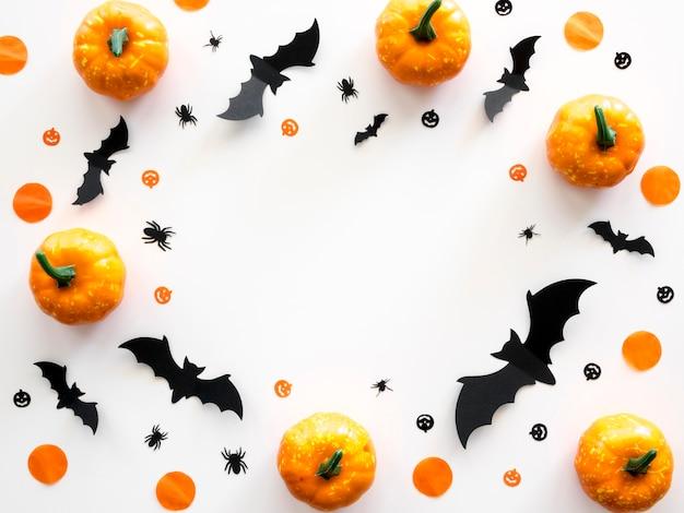 Top view halloween concept with pumpkins and bats Premium Photo