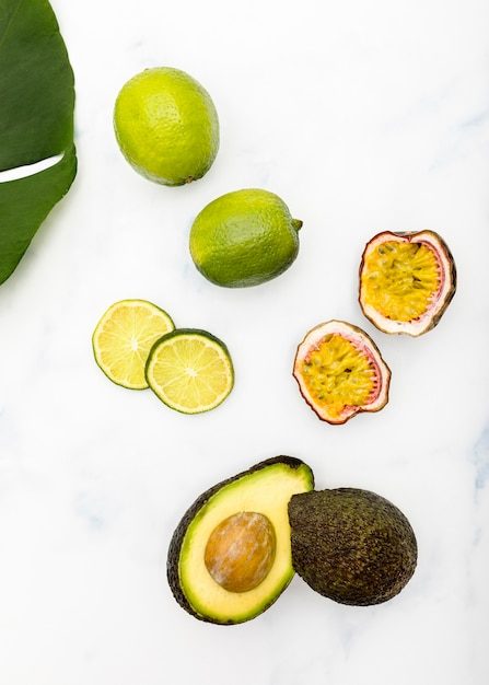 Top view halves of tropical summer fruit Free Photo