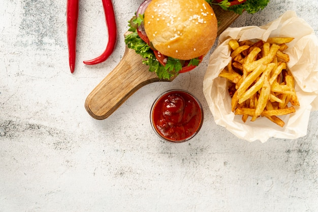 Top view hamburger with french fries Free Photo