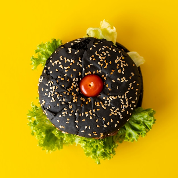 Top view hamburger with yellow background Free Photo
