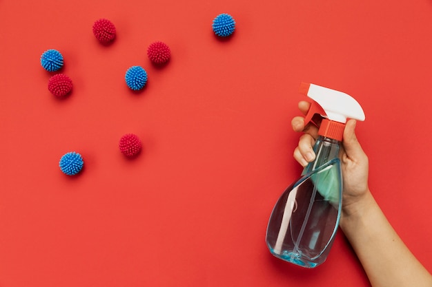Top view hand holding disinfectant with decorative balls Free Photo