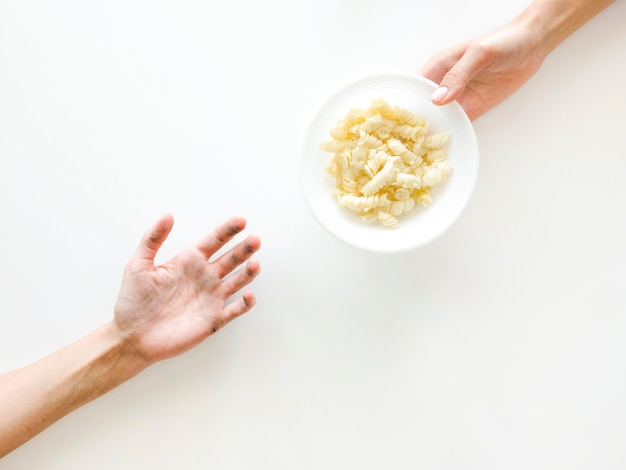 Top view of hands exchanging food Free Photo