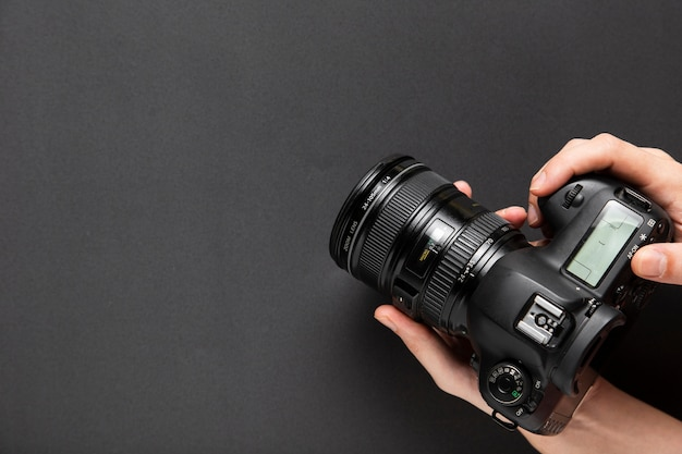 Top view of hands holding a camera with copy space Free Photo