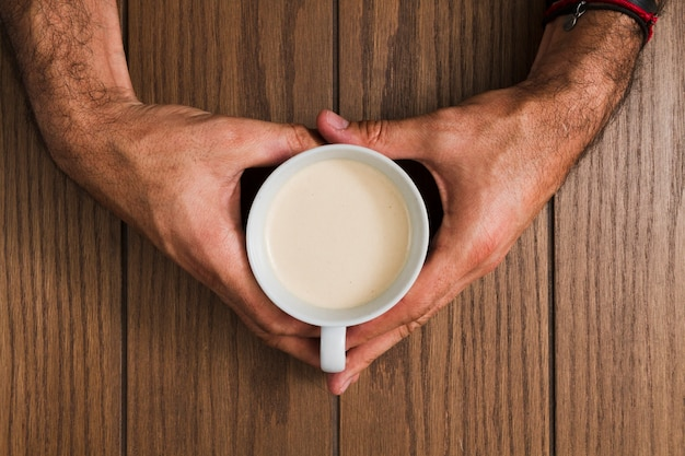 Top view hands holding cup of coffee Free Photo