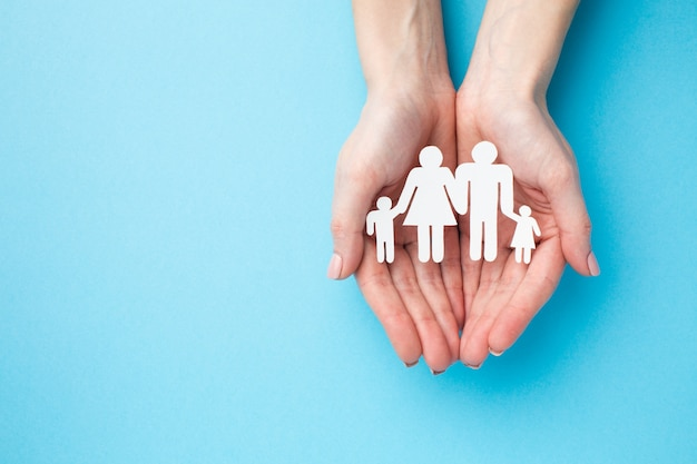Top view hands holding family figure with copy space Free Photo