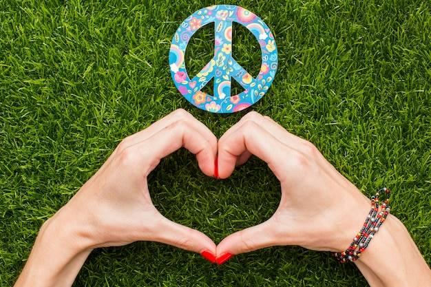 Top view of hands making heart with peace sign Free Photo