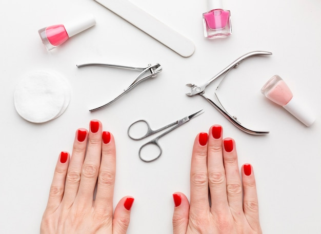 Top view hands surrounded by beauty products Free Photo