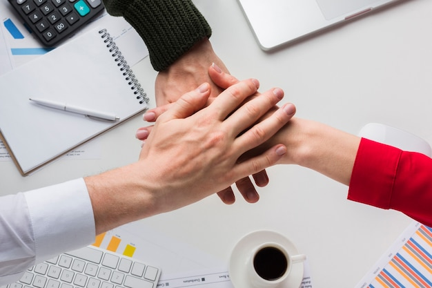 Top view of hands together over desk Free Photo