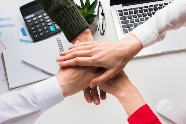 Top view of hands together over work desk Free Photo