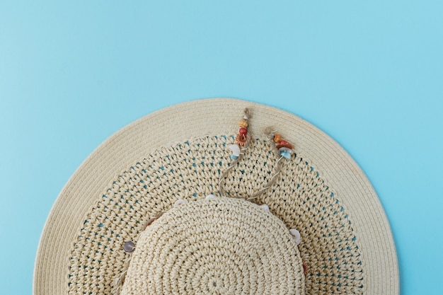 Top view of hat on blue background Free Photo