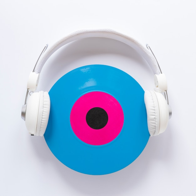 Top view headset with a vinyl disc Free Photo