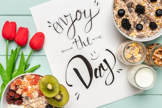 Top view healthy breakfast with tulips Free Photo