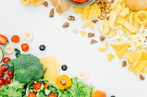 Top view healthy food vs unhealthy food Free Photo