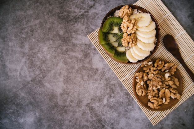 Top view healthy fruit and nuts breakfast Free Photo
