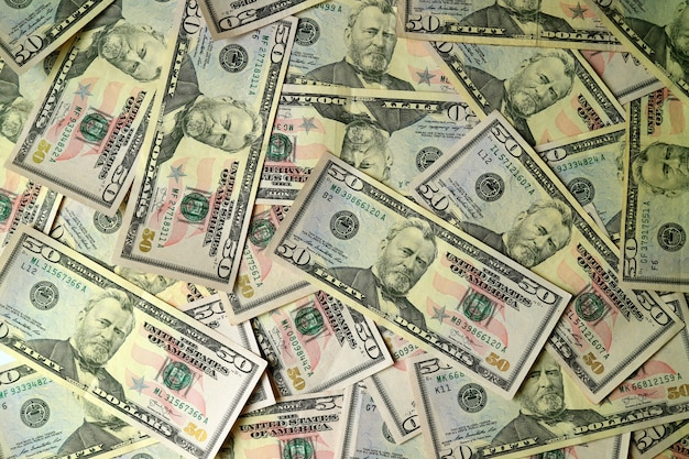 Top view of the heap of united states fifty dollar bills Premium Photo