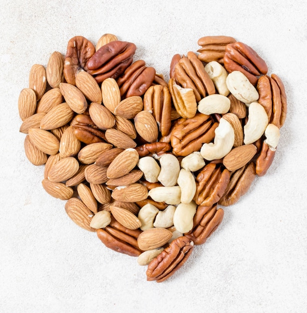 Top view of heart made of walnuts and almonds Free Photo