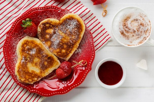 Top view of heart-shaped pancakes with strawberry Free Photo