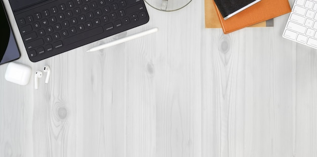 Top view of hipster freelancer workplace with office supplies Premium Photo