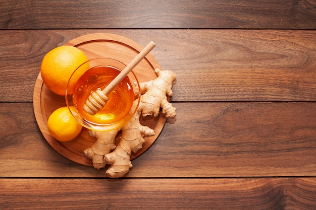 Top view homemade honey with ginger and lemon Free Photo