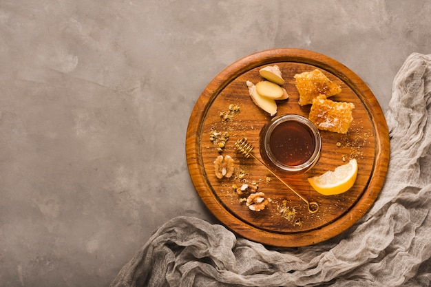 Top view honey jar with food and honeyspoon Free Photo