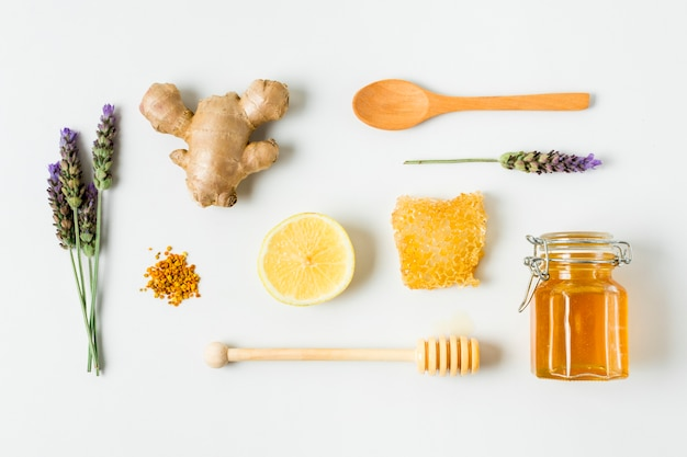 Top view honey jar with lavender, lemon and ginger Free Photo