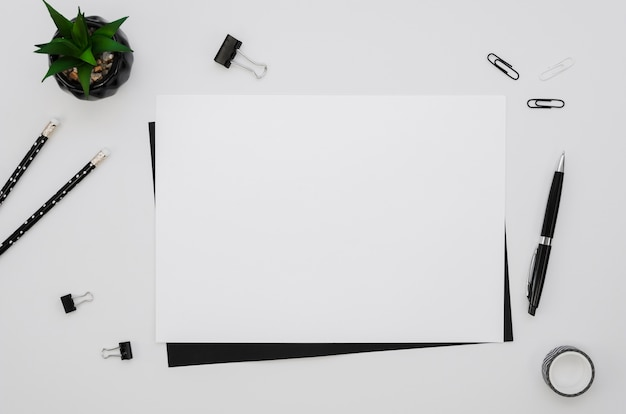 Top view of horizontal paper with office supplies Free Photo
