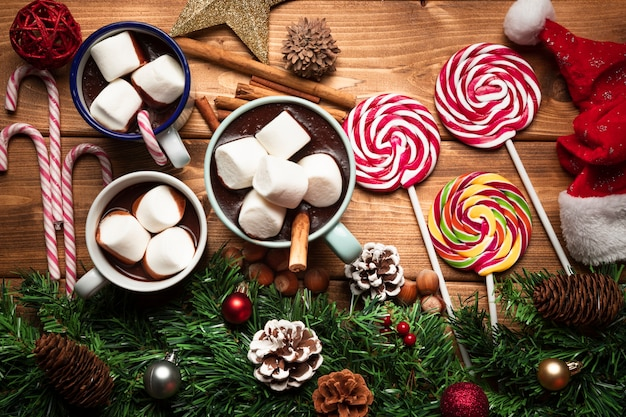 Top view hot chocolate with sweets Free Photo