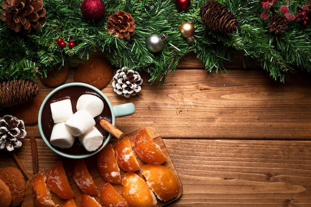 Top view hot chocolate with wooden background Free Photo
