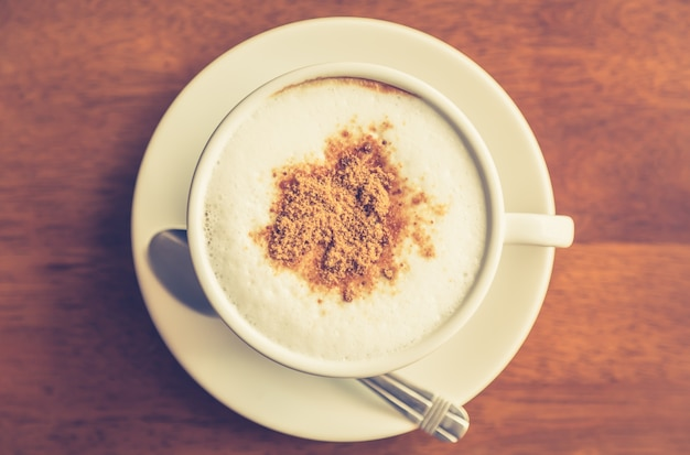 Top view of hot coffee with cinnamon Free Photo