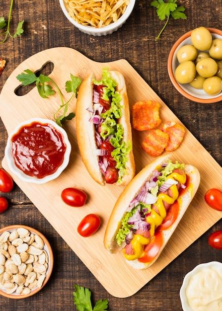 Top view of hotdogs on cutboard Free Photo