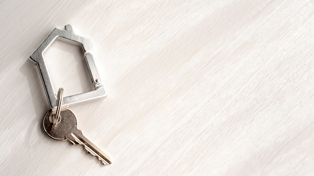 Top view house keys on copy space background Free Photo